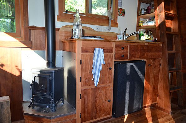 Hobbit Wood Stove in Small House